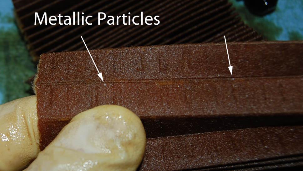 Need advice looks like metallic material in filter - Fabric that looks like metal ...